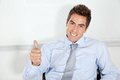 Young businessman gesturing thumbs up portrait of handsome in office Royalty Free Stock Photos