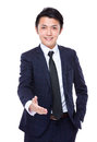 Young businessman with hand shaking isolated on white background Stock Photography