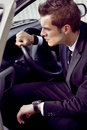 Young businessman in his car at the wheel Royalty Free Stock Photography