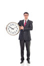 Young businessman holding a clock image Royalty Free Stock Images