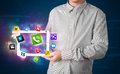 Young businessman holding tablet modern colorful apps icons Royalty Free Stock Photography