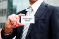 Young businessman holding visit card in hand Royalty Free Stock Photo