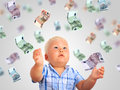 Young businessman kid and a lot of money Royalty Free Stock Image
