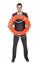 Young businessman with life buoy Royalty Free Stock Photos