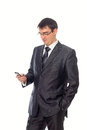 Young businessman looking at cell phone isolated image Royalty Free Stock Photography