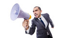 Young businessman with loudspeaker on white Stock Photo