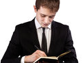 Young businessman making notes in a notebook Stock Images