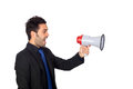 Young businessman megaphone proclaiming something isolated white background Royalty Free Stock Image