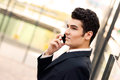 Young businessman in an office building talking on the phone Royalty Free Stock Photos