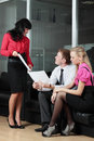 The young businessman at office with colleagues Stock Photo
