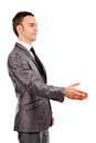 Young businessman with an open hand ready to seal a deal isolated on white background Royalty Free Stock Images
