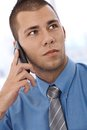 Young businessman on phone Stock Photos