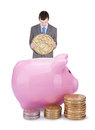 Young businessman with pigggy bank Royalty Free Stock Image