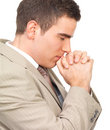 Young businessman praying, hands together. Royalty Free Stock Photos