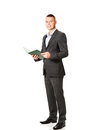 Young businessman reading his note book smiling handsome Stock Photos