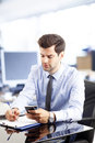 Young businessman reading a text message successful making phone call or writing an sms messaging Stock Photos