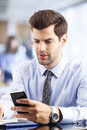 Young businessman reading a text message successful making phone call or writing an sms messaging Royalty Free Stock Photo