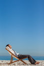 Young businessman resting on his deck chair Royalty Free Stock Photo