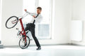 Young Businessman Rides on His Bike at Office. Business People Royalty Free Stock Photo