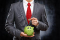 Young businessman saving money Royalty Free Stock Photo