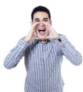 Young businessman shouting loud with hands on the mouth Stock Photos