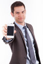 Young businessman showing a smartphone Stock Photos