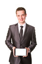 Young businessman showing a tablet pc comuter with blank screen for your sample text Royalty Free Stock Photo