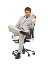 Young businessman sitting in chair picture of Stock Image