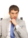 Young businessman sitting in chair picture of Royalty Free Stock Photography