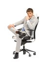 Young businessman sitting in chair picture of Royalty Free Stock Photos