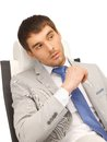 Young businessman sitting in chair picture of Royalty Free Stock Photo