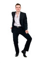 Young businessman in suit dancing isolated on white background Stock Image