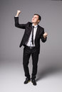 Young businessman in suit winner victory celebrate Royalty Free Stock Photo