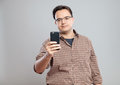 Young businessman taking photos with mobile phone Royalty Free Stock Photo