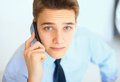 Young businessman talking on cell phone Royalty Free Stock Photo
