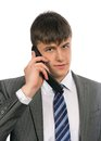 Young businessman talking on mobile Stock Photos