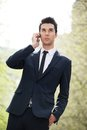 Young businessman talking on phone outside the office portrait of a Royalty Free Stock Photo