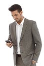 Young businessman texting on mobilephone using writing text message Royalty Free Stock Photography
