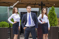 A young businessman with their secretaries outdoor summer street Royalty Free Stock Photography