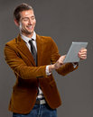 Young businessman touching a tablet screen. Stock Photo