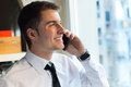 Young businessman using his mobile phone in office portrait of Royalty Free Stock Photo