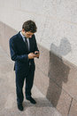 Young businessman using his phone in a street photography of Stock Photos