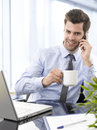 Young businessman using laptop happy businesman in his office Royalty Free Stock Image
