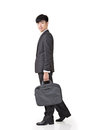 Young businessman walk hold briefcase and full length portrait isolated on white background Royalty Free Stock Photos