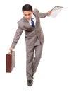 Young businessman walking maintain balance