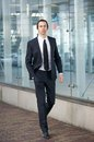 Young businessman walking on sidewalk in a suit full body portrait of confident Royalty Free Stock Images