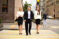 A young businessman walking on the street with their secretaries outdoor summer Stock Image