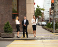 A young businessman walking on the street with their secretaries outdoor summer Stock Photography
