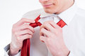 Young businessmans hands tying a red tie close up of businessman Stock Photo