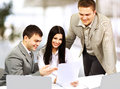 Young businesspeople discuss the new project at office Royalty Free Stock Photo